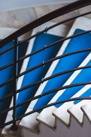 Blue background made for Old blue spiral staircase inside an old house. Color 2020.