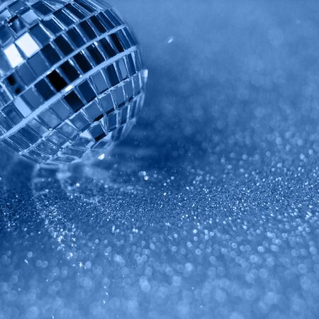 Blue background, Close-up Crystal ball Decorated on Christmas night on a shiny background. Color 2020.