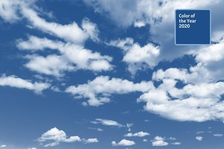 Bright blue sky with white varied clouds. 2020 color trendtext 版權商用圖片