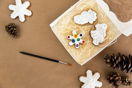 Christmas gingerbread cookies in the form of a mouse with icing set in a box to be painted. Christmas fun for kids.