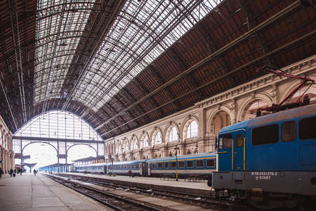 BUDAPEST, HUNGARY - 25 Juanary 2019: Locomotives and coaches and passengers on the Keleti Railway Station in Budapest, the oldest in Europe.