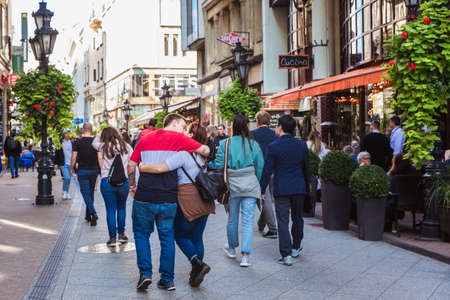 Budapest, Hungary. October 2019: Tourists and visitors on the famous Vaci Street, the main shopping fashion street in Budapest, Hungary. Редакционное