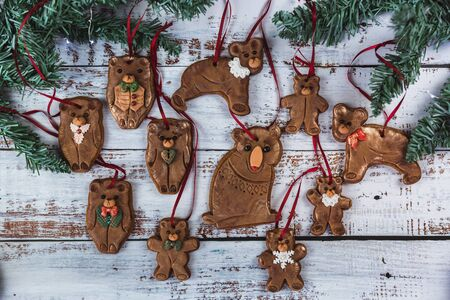 Hand painted Christmas gingerbreades bear family on a beautiful wooden background. Card concept. Top view. Flat lay