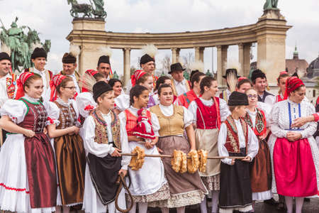 BUDAPEST, HUNGARY, 06 APRIL 2019: Spring celebration parade through the Budapest streets. Folk Dancers in national costumes in the Heroes Square