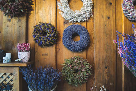 Spring wreaths of dried flowers at the decoration and flower shop