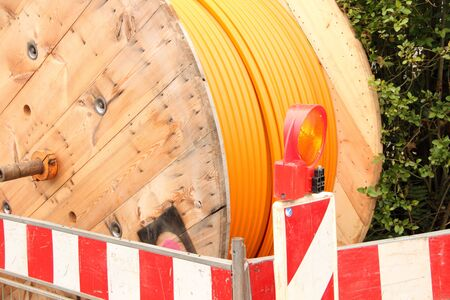 Orange fiber optic cable on the street