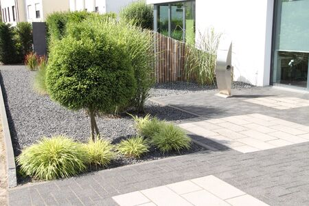 A modern front yard with stones and plants 스톡 콘텐츠