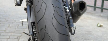 A motorcycle tire from behind with exhaust Stock Photo