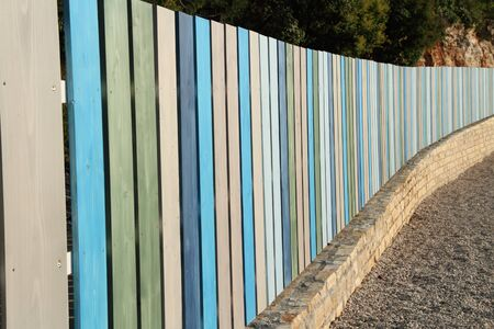 A colorful new wooden fence colorful wooden fence Stock Photo