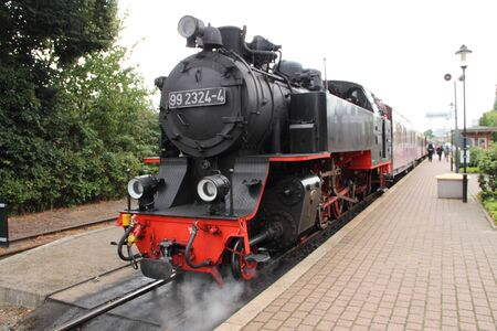 Old steam locomotive at the train station Stock Photo