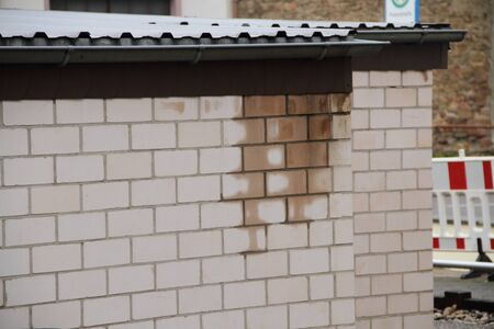 Water damage on a wet stone wall Banco de Imagens