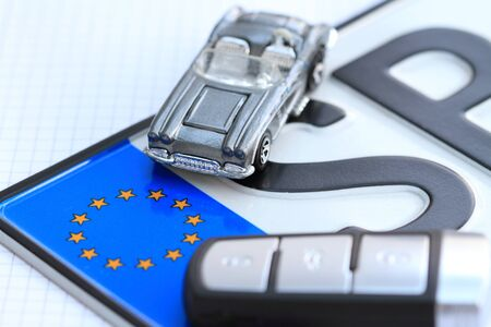 License plate with a car key