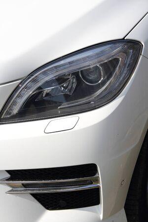 A white car with modern headlight