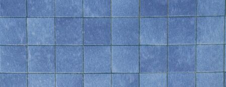 A wall with blue tiles