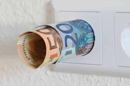 A double socket with banknotes Foto de archivo
