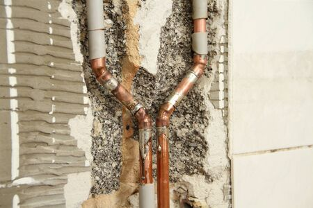 A new water pipe is laid in the bathroom