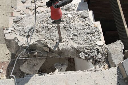 Demolish an old staircase with a demolition hammer