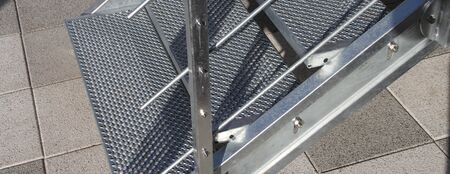 A galvanized steel staircase with railing Stockfoto