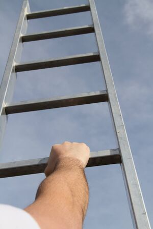A man is trying to get up the ladder