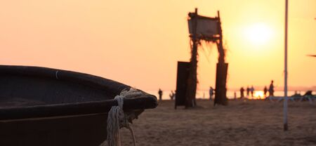 A boat on the beach with sunset
