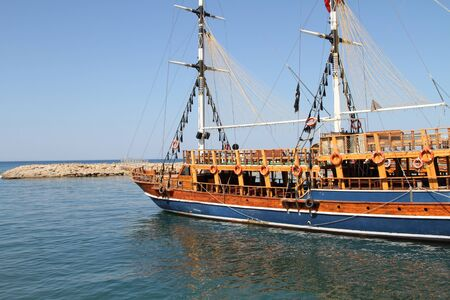 A sailing ship with tourists in the harbor Archivio Fotografico