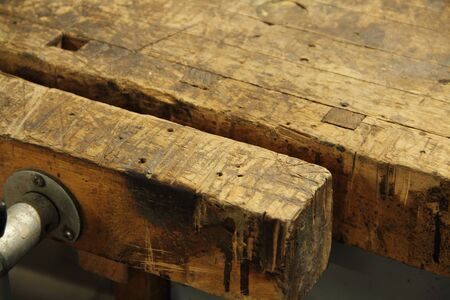 An old workbench in the basement Archivio Fotografico