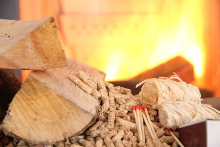 Wood pellets with fire in the background Stockfoto