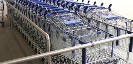 Many shopping carts in front of a supermarket