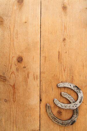 Horseshoe on a board Reklamní fotografie