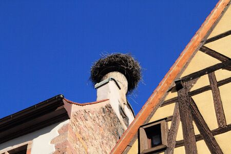 A stork's nest on a roof in Alsace Banque d'images