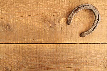 Horseshoe on a board