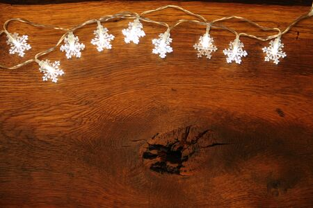 Wooden board with fairy lights as a background