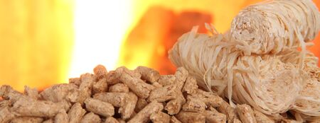 Wood pellets with fire in the background