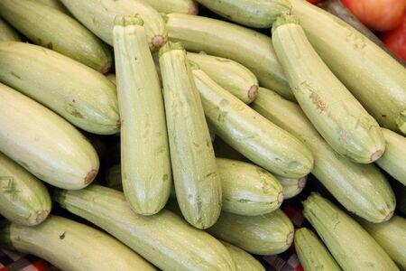 Many green zucchini on a market 스톡 콘텐츠