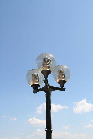 A beautiful old three-lamp street lamp