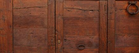 An old wooden door as a background Imagens