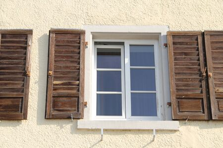 Old windows with a wooden shutter