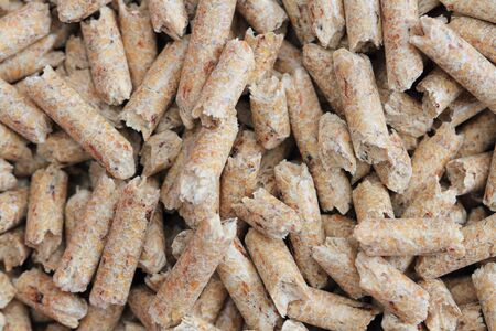 Many wood pellets as a background