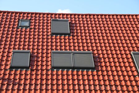 A house with new roof window Standard-Bild