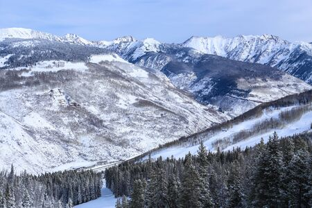 Vail Ski Resort and a view of the snow covered Rocky Mountains in winter