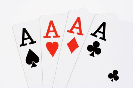 Four aces on white background Imagens