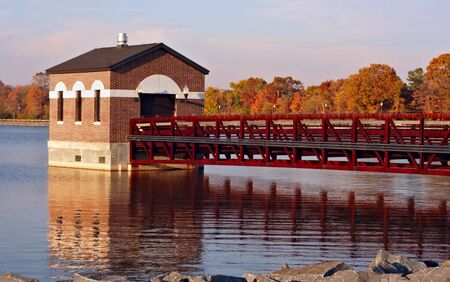 Reservoir in the fall with colorful leaves and reflections in the water