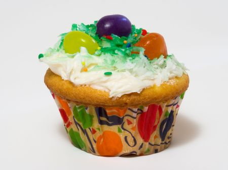 Cupcake with white icing and jelly beans