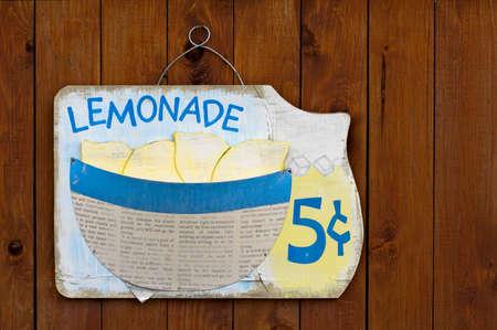Wooden lemonade sign on wood fence