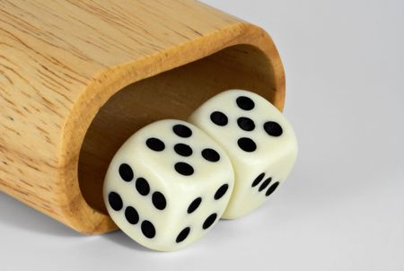 Shaker and dice showing 55