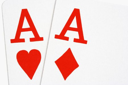 Ace of hearts and ace of diamonds on white background Imagens