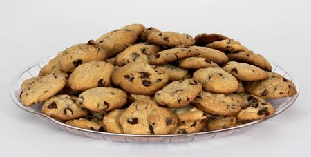 An isolated tray of chocolate chip cookies on a white background Imagens