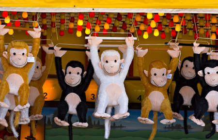Prize monkeys at a game of chance on a seaside boardwalk. photo