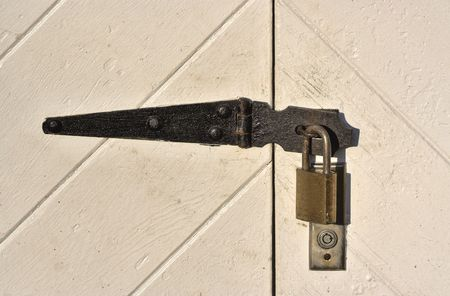 Close up of a padlock on old barn doors Stock Photo - 706074