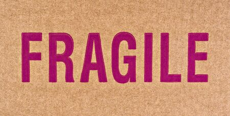 The word FRAGILE in red on a brown cardboard box. Stock Photo - 749734